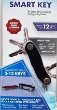 COMPACT SMART KEY HOLDER. SIMPLE & CLEVER DESIGN HOLDS 2-12 KEYS. PERFECT GIFT