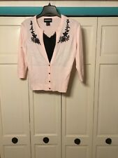 womens or girls sweater brand requirements size small color pink / blk.