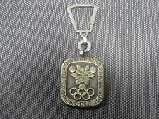 Ancien porte clé JO de Grenoble 1968 Jeux Olympiques Arthus-Bertrand Paris