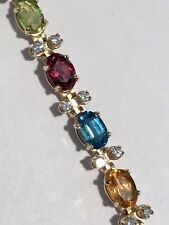 14kt yellow gold diamond tennis bracelet with multi color precious oval stones