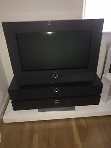 Loewe Articos 30 16:9 HD CRT TV in Basalt on matching motorized cabinet / stand
