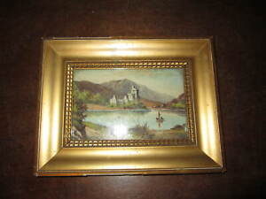 A small old framed oil painting - signed
