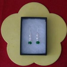 Orecchini di lusso con gemme verde tondi in argento