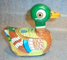old tin litho key wind egg laying duck toy