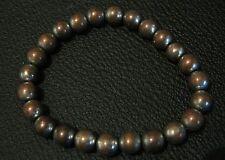 Lovely elasticated beaded bracelet with bronze tone beads