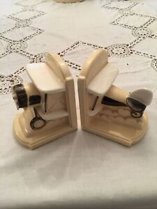 AIRPLANE BOOKENDS CERAMIC 1918 ON EACH PIECE IN NICE CONDITION. SEE PHOTOS