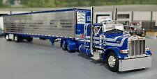 1/64 DCP PETERBILT 379 BLUE/SILVER & CHROME SIDE SPREAD AXLE TRAILER NEW IN BOX