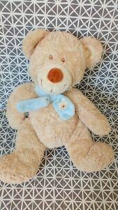 Doudou peluche ours beige écharpe bleue Nicotoy 25 cm