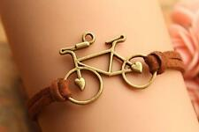 BRONZE BICYCLE WITH BROWN SUEDE BRACELET - FREE UK P&P.......CG0171