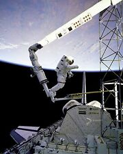 Astronaut Jerry Ross at the end of Space Shuttle Atlantis robot arm Photo Print
