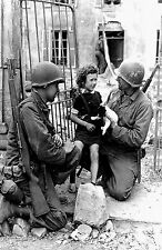 WW2 Photo US Soldiers wit a M1 Helmet helping a girl an her dog WWII 091