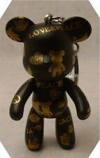 "POPOBE 3""key chain love and peace black  body  and gold logos bear"