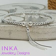 Inka Sterling Silver Stretch bead Stacking Bracelet with Dainty Tassel charm