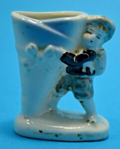 SMALL Occupied Japan figurine boy with blue vase