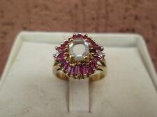 anello oro giallo 18 .kt  diamanti rubini  naturali + diamante 0,50 k.ottagonale