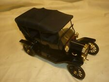 A Franklin mint scale model car of a 1913 Model T Ford touring,