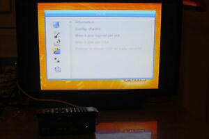 decodeur tnt hd AXIL RT0407HD  avec sa telecommande