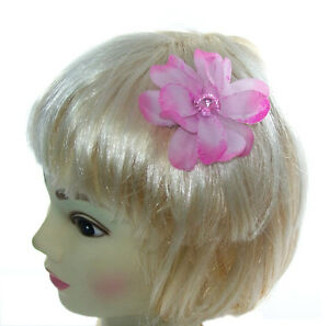 small pink hair flower with gem center on a small clip