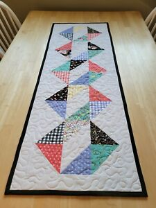 Handmade quilted table multicolored on white