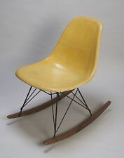 Yellow Herman Miller Charles Eames Side Shells with walnut rocker bases