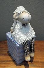 Happy sitting Shaggy Sheep ornament with dangly legs