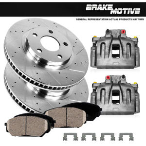 Front OE Calipers +D/S Brake Rotors +Ceramic Pads For Volvo C70 S40 V50