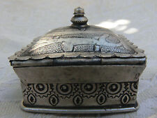 Old Moroccan white metal box with geometric designs.