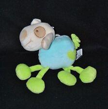 Peluche doudou chien crème musical CP INTERNATIONAL cocard bleu vert coeur TTBE