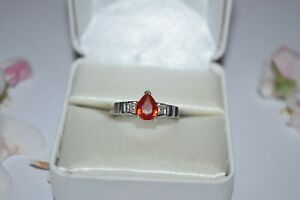 9ct White Gold Treated Red Sapphire Pear Cut Ring With Diamond Shoulders