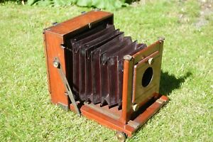 Vintage wooden folding bellows plate camera