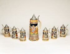 Set of 7 German beer steins with pewter lids and music box in perfect condition