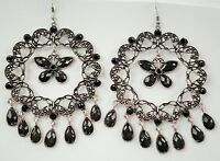 Large silver tone and black faceted glass drop earrings Approx. 10.5cm on hooks