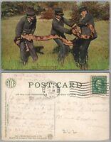 NEW YORK ZOO N.Y. 1924 ANTIQUE POSTCARD HANDLING A PYTHON