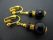 A PAIR OF BLACK ONYX GOLD PLATED DROP DANGLY CLIP ON  EARRINGS. NEW.
