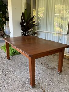 Solid timber extendable dining table.
