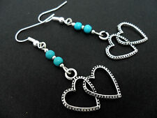 A PAIR OF DANGLY TIBETAN SILVER   HEARTS  TURQUOISE BEAD EARRINGS.  NEW.