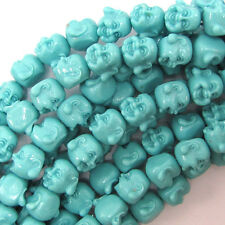 """12mm synthetic coral carved buddha beads 7"""" strand blue"""