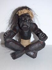 Vintage African Wood Carving of Seated Male Native with Long Hair and Loin Cloth