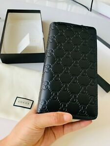Gucci GG Embossed Leather Wallet in Bla