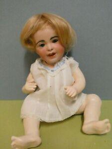 Poupée ancienne: Charmant petit bébé SFBJ 236 taille 2  24 cm.