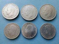 25 monedas y español