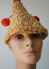 Vintage straw pointed hat with dangling pom poms wonderful!