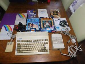 COMMODORE AMIGA 600 & GAMES & JOYSTICK & BOOKS & MOUSE - WORKING