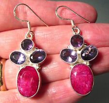 925 sterling silver heavy faceted ruby & amethyst earrings.