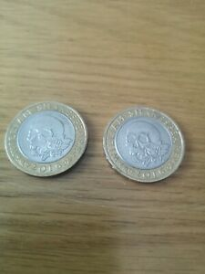 £2 pound coin. One with minting error. For king and country. Shakespeare.