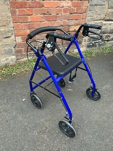 Blue 4 Wheel Walker With Seat & Basket Collapsible For Storage Or To Go In Car