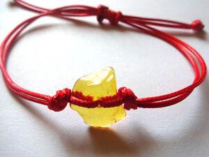 Red bracelet  Amber charm for good luck and protection adjustable bracelet !