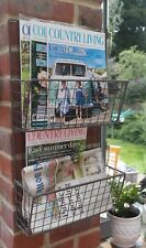 Wall mounted grey wirework magazine / brochure rack