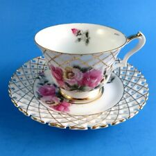 Reticulated Floral Motif Castle China Japan Cup and Saucer (small paint blemish)