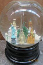 "saks fifth avenue musical snow globe "" world """